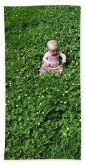 Baby In A Field Of Flowers Bath Towel