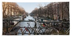 Bath Towel featuring the digital art Bikes On The Canal In Amsterdam by Carol Ailles