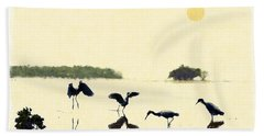 Hand Towel featuring the photograph birds feeding in the Everglades by Dan Friend