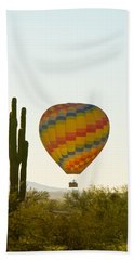 Hot Air Balloon In The Arizona Desert With Giant Saguaro Cactus Hand Towel