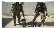 Iraqi Army Soldiers Find A Weapons Bath Towel