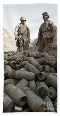 Marines Stand Over A Pile Of Unused Bath Towel
