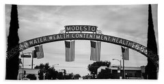 Modesto Arch With Flags Hand Towel by Jim And Emily Bush