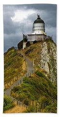 Nugget Point Light House And Dark Clouds In The Sky Hand Towel
