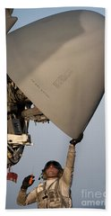 Petty Officer Inspects The Radar Of An Hand Towel