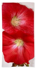 Red Hollyhocks Bath Towel by Donna Walsh