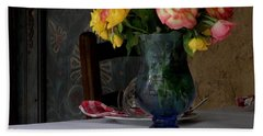 Bath Towel featuring the photograph Roses In Blue Glass Vase by Lainie Wrightson