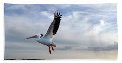 Hand Towel featuring the photograph White Pelican Flying Over Island by Dan Friend