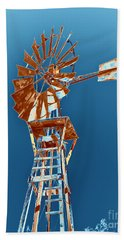 Windmill Rust Orange With Blue Sky Bath Towel by Rebecca Margraf
