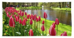 Bath Towel featuring the photograph Colorful Blooming Tulips by Hans Engbers
