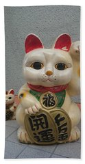 A Figure Of A Beckoning Cat, Called 'manekineko' Bath Towel