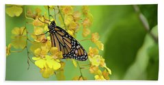 Monarch Butterfly On Yellow Orchids Bath Towel
