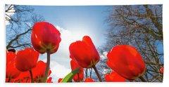 Red Tulips Against Blue Sky Bath Towel
