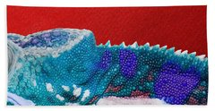 Turquoise Chameleon On Red Bath Towel