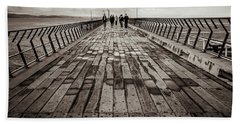 Walking The Pier Hand Towel by Perry Webster