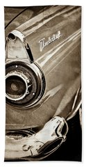 Hand Towel featuring the photograph 1956 Ford Thunderbird Taillight Emblem -0382s by Jill Reger