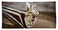Hand Towel featuring the photograph 1956 Lincoln Premiere Convertible Hood Ornament -2797ac by Jill Reger