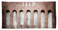 Hand Towel featuring the photograph 1957 Jeep Emblem -0597ac by Jill Reger