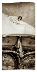 Bath Towel featuring the photograph 1957 Mercury Turnpike Cruiser Emblem -0749s by Jill Reger