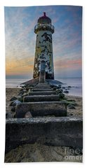 Sunset At The Lighthouse Hand Towel by Ian Mitchell