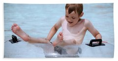 A Boy In A Pool In A Transparent Lifesaver Hand Towel