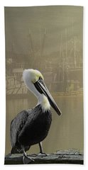 A Foggy Pelican Sunset Bath Towel by Diane Schuster
