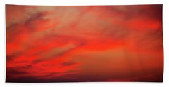 a gorgeous sunset with luminous red clouds over the Yala Nationalpark Hand Towel