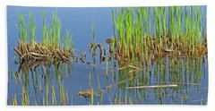 Hand Towel featuring the photograph A Greening Marshland by Ann Horn