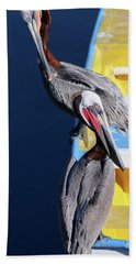 A Pair Of Brown Pelicans On A Blue And Yellow Rowboat Hand Towel