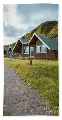 Bath Towel featuring the photograph A Row Of Cabins In Iceland by Edward Fielding