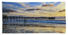 A Surfer Heads Home Under A Cloudy Sunset At Crystal Pier Hand Towel