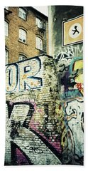 A Wall Of Berlin With Graffiti Bath Towel