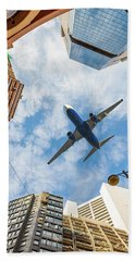 Airplane Above City Hand Towel