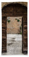 An Old Wooden Door 2 Bath Towel by Andrea Mazzocchetti