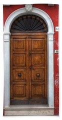 an old wooden door in Italy Bath Towel