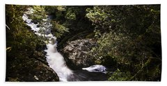Beautiful Nature Landscape Of A Flowing Waterfall Hand Towel