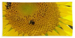 Hand Towel featuring the photograph Bees Share A Sunflower by Sandi OReilly