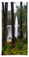 Between The Fountain Bath Towel by Lori Mellen-Pagliaro