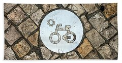Bike Path Sign On A Cobblestone Pavement Bath Towel