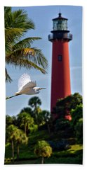 Bird In Flight Under Jupiter Lighthouse, Florida Bath Towel by Justin Kelefas