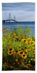 Blooming Flowers By The Bridge At The Straits Of Mackinac Bath Towel