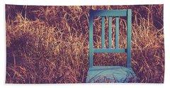 Blue Chair Out In A Field Of Talll Grass Bath Towel by Edward Fielding