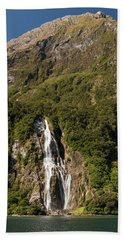Hand Towel featuring the photograph Bowen Falls Milford Sound by Gary Eason