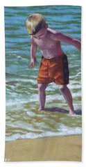 boy at Bournemouth beach Hand Towel