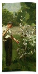 Bath Towel featuring the painting Boy With A Grass Rake by Henry Scott Tuke