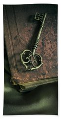 Brass Ornamented Key On Old Brown Book Bath Towel by Jaroslaw Blaminsky