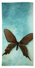 Brown Butterfly Over Blue Textured Background Hand Towel