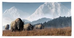 Buffalo Grazing Hand Towel by Daniel Eskridge
