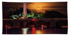 Burning Moon Rising Over Jupiter Lighthouse Bath Towel by Justin Kelefas