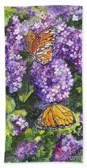 Bath Towel featuring the painting Butterflies And Lilacs by Carol Wisniewski